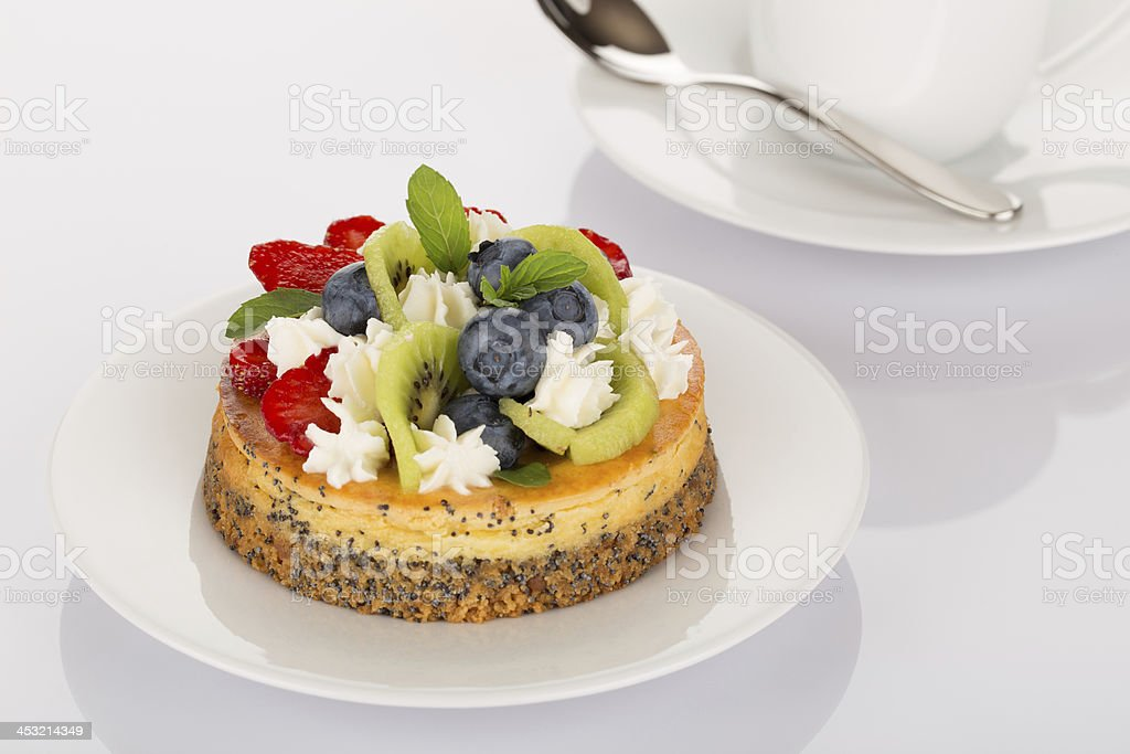Cheesecake, strawberries, blueberries and kiwi royalty-free stock photo