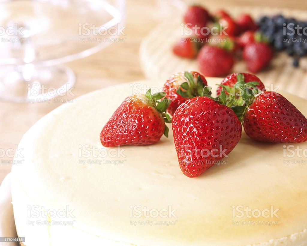 cheesecake topped with strawberries stock photo