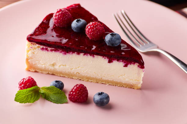 Cheesecake with berries on wooden background stock photo