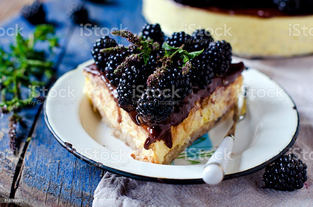Cheesecake with chocolate and blackberries stock photo