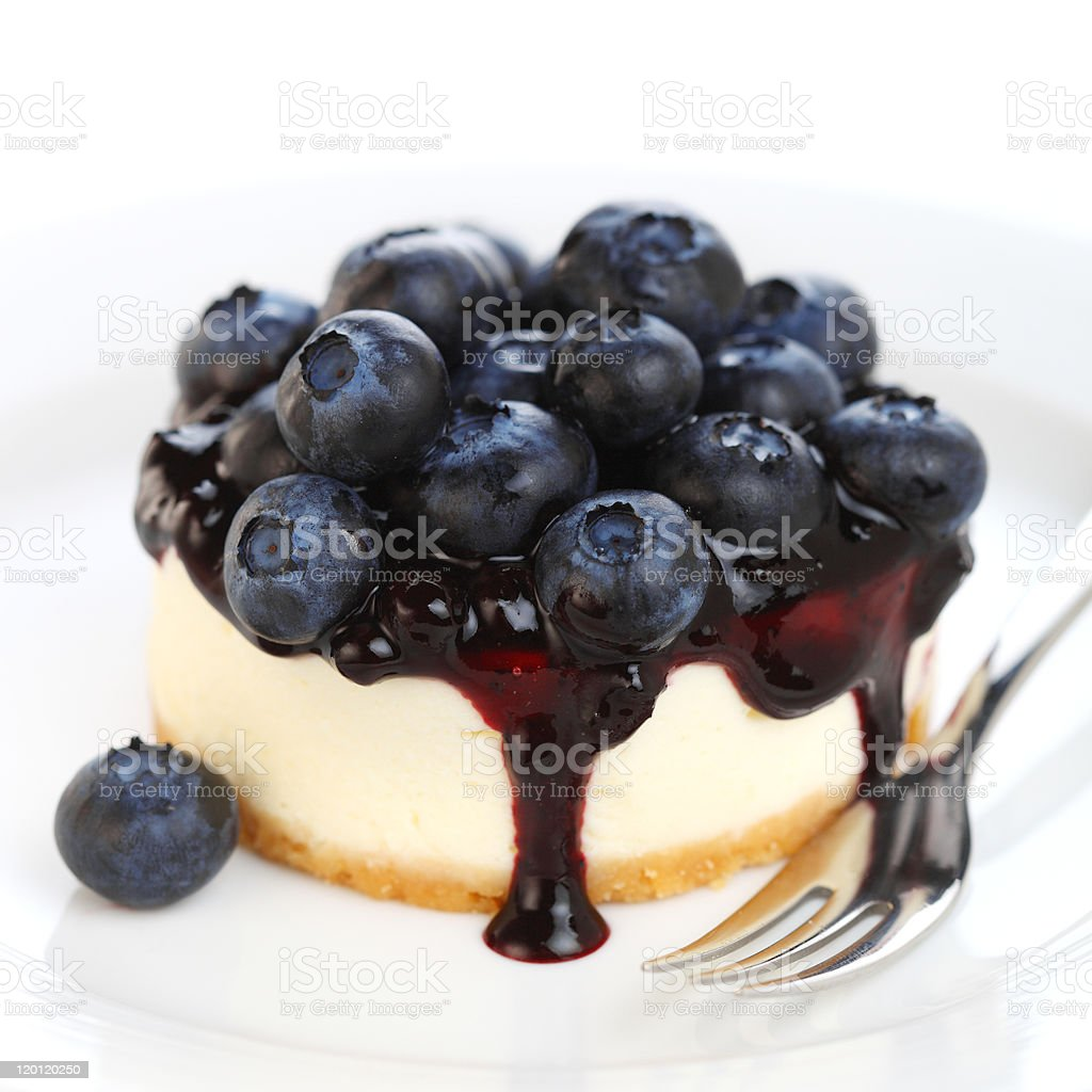 Cheesecake with fresh blueberries on white isolated background stock photo