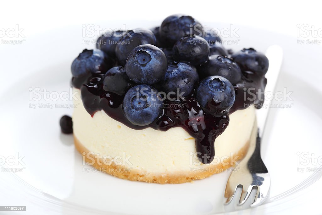 Cheesecake with fresh blueberries on white plate closeup royalty-free stock photo