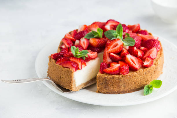 cheesecake  with fresh strawberry on white background stock photo