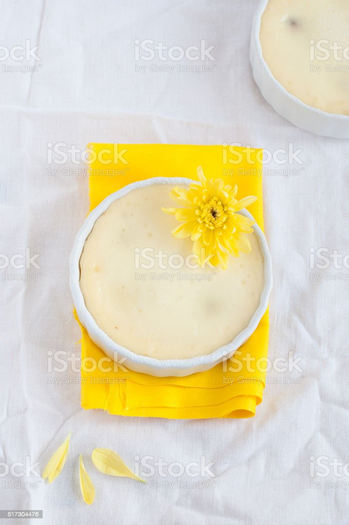 Cheesecake with yellow flower, top view stock photo