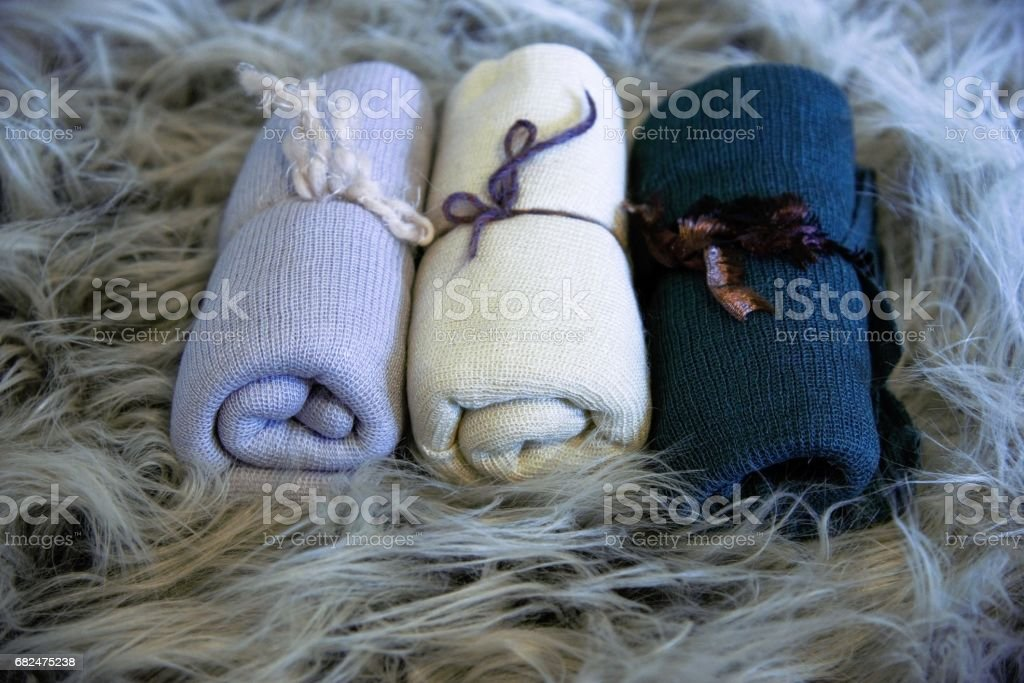 Cheesecloth newborn wraps on fur background royalty-free stock photo