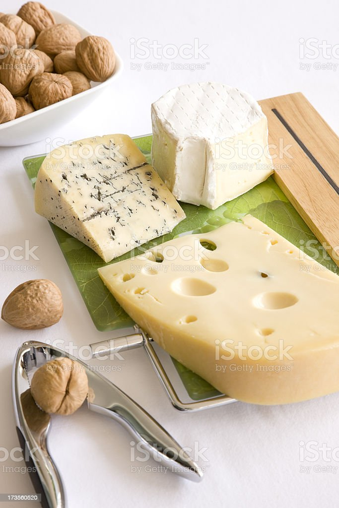 Cheeses and nuts royalty-free stock photo