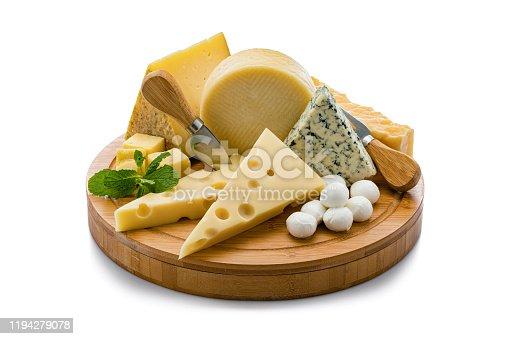 Wooden board with a variety of cheeses isolated on white background. Cheeses included in the composition are Manchego cheese, goat cheese, emmental cheese, Roquefort cheese, mozzarella cheese and Cheddar cheese. Predominant colors are yellow and white. High resolution 42Mp studio digital capture taken with Sony A7rii and Sony FE 90mm f2.8 macro G OSS lens