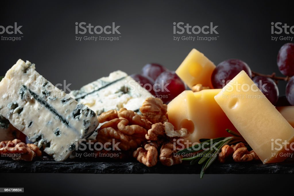 Cheeses , grapes and walnuts . royalty-free stock photo