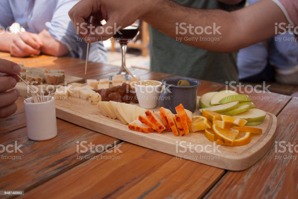 cheeses near me to taste with bread,  wine, fruits, olives, and honey stock photo