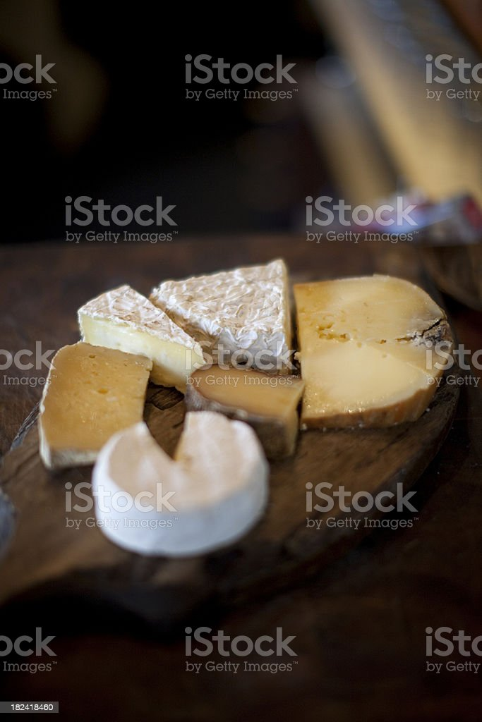 Cheeses on a cheese board stock photo