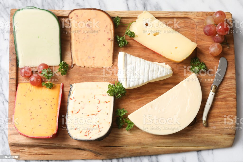 Cheeses On A Cutting Board stock photo
