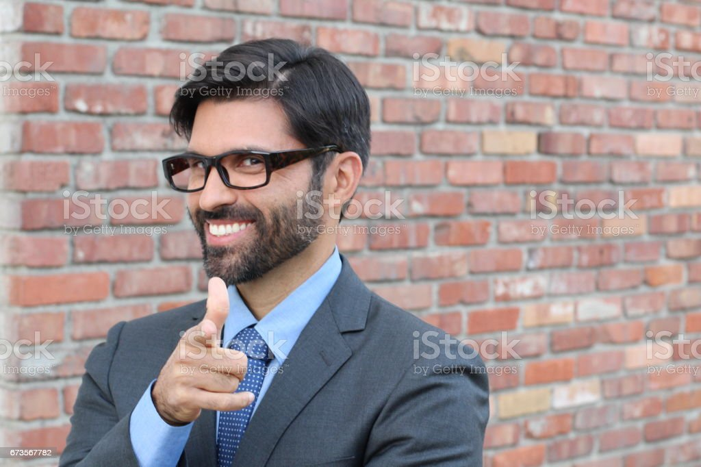 Cheesy Businessman Pointing at YOU stock photo