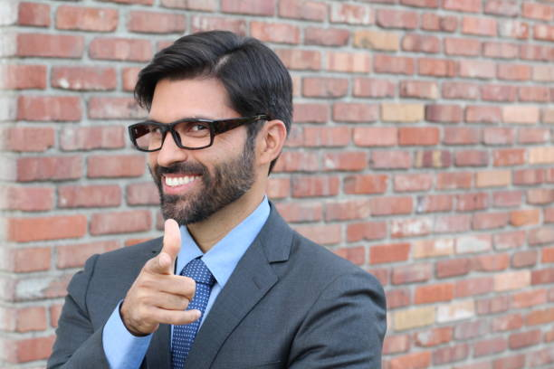 Cheesy Businessman Pointing at YOU Cheesy Businessman Pointing at YOU. cheesy grin stock pictures, royalty-free photos & images