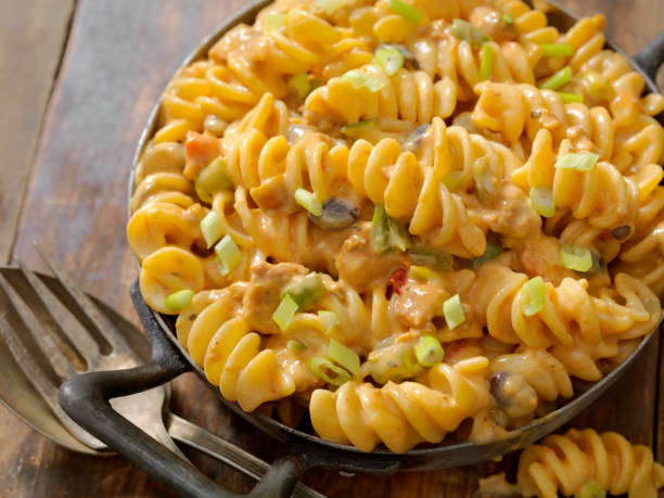 Cheesy, Chili Rotini Rotini in a Cheesy, Chili Sauce fusilli stock pictures, royalty-free photos & images