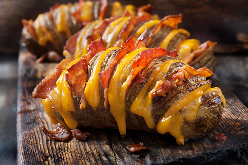 Cheesy, Hasselback Potatoes Stuffed with Cheddar and Bacon