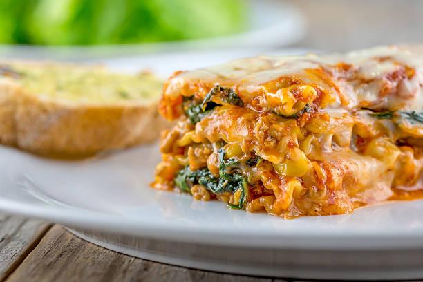 Cheesy lasagna with garlic bread and salad picture id532443483?b=1&k=6&m=532443483&s=612x612&w=0&h=6bec08b2ipdduk9rql3t7xjsq 6zcmzlk0uszuala4s=