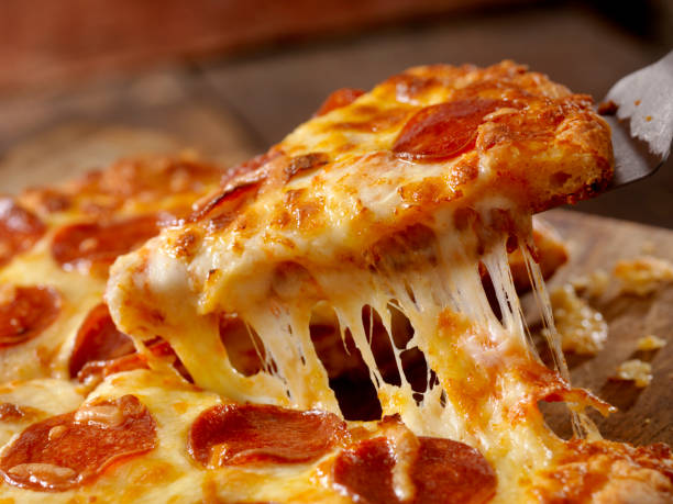 Cheesy Pepperoni Pizza Cheesy Pepperoni Pizza Pull pulling stock pictures, royalty-free photos & images