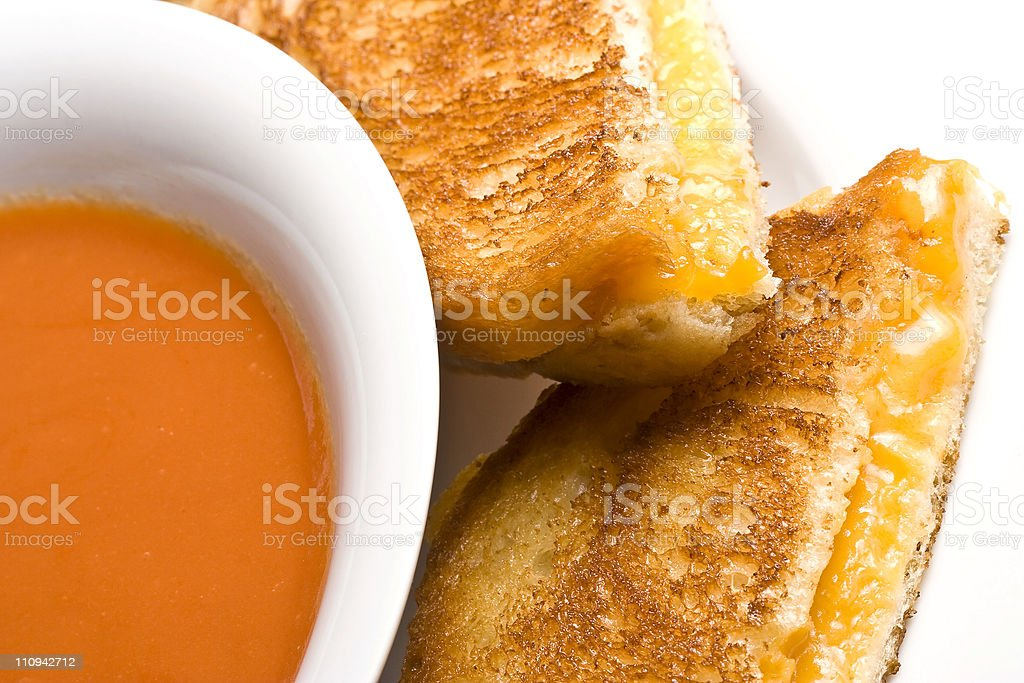 A cheesy toast of bread with an orange juice royalty-free stock photo