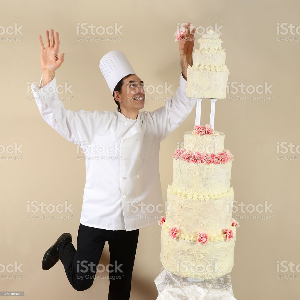 Chef and a Very Tall Cake stock photo