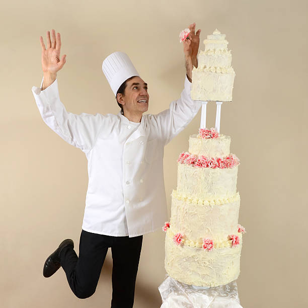 chef and a very tall cake - big cake stock photos and pictures