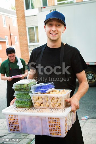 istock Chef and assistant bringing in fresh produce delivery 518177531