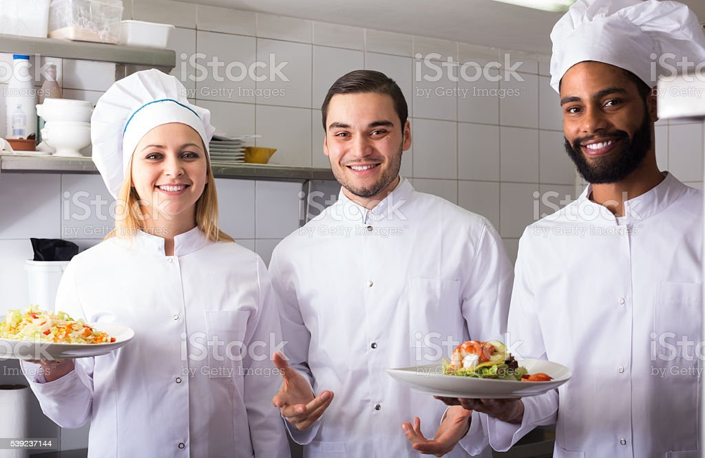 chef and his assistants preparing meal royalty-free stock photo