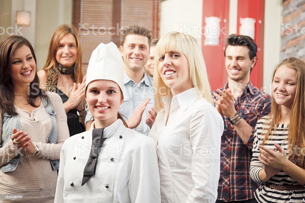 chef and waiter with their guests royalty-free stock photo