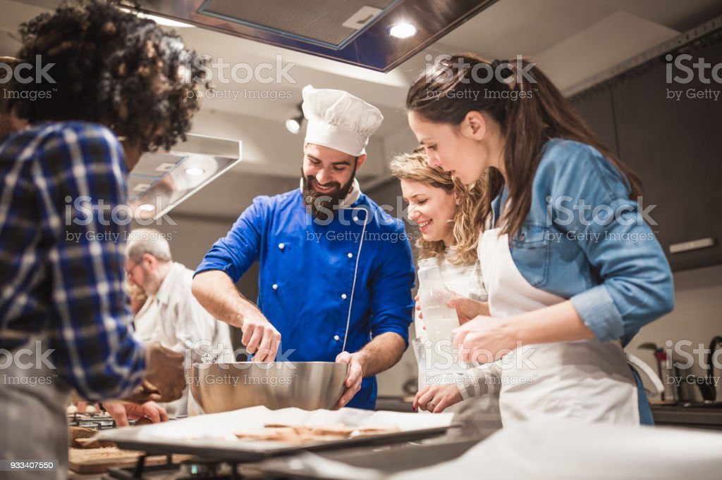 Chef assisting cooking class stock photo