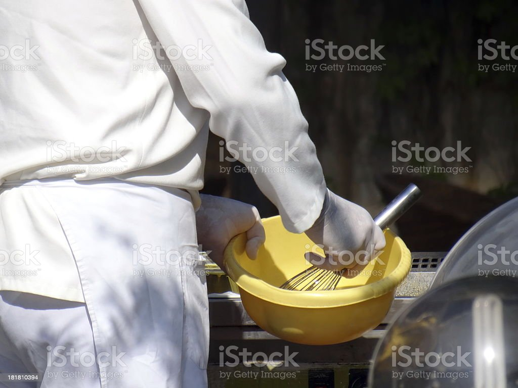 Chef beating eggs royalty-free stock photo