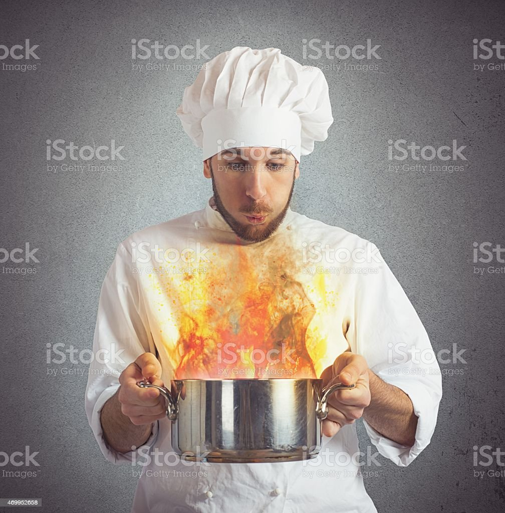 Chef blowing burnt food stock photo