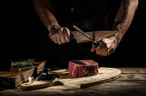 Chef butcher prepare beef steak - foto de acervo