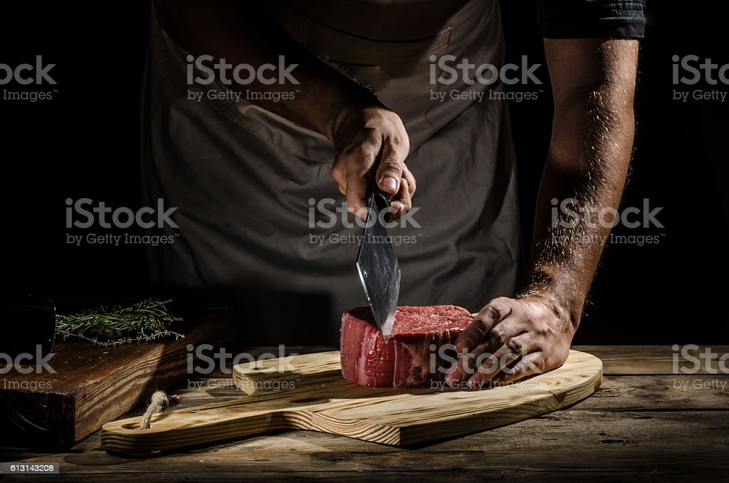 Chef butcher prepare beef steak stock photo