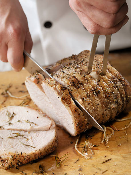Chef Carving a Pork Roast  carving knife stock pictures, royalty-free photos & images
