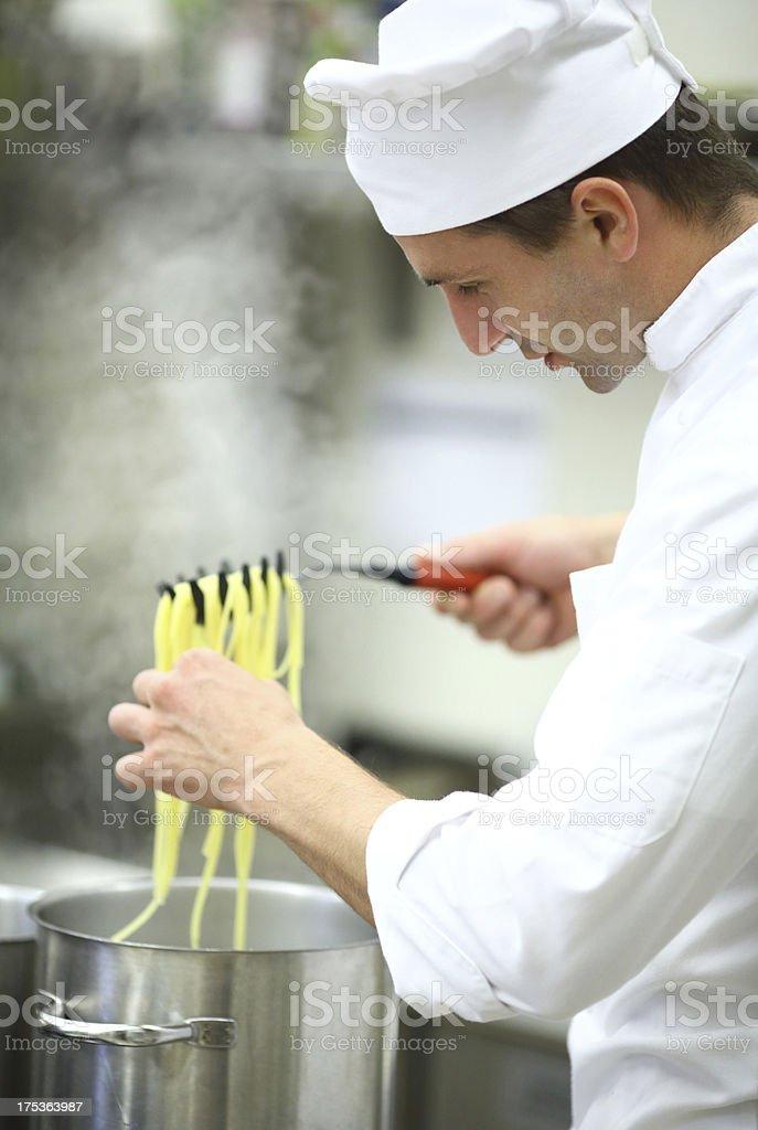 Chef checking pasta. royalty-free stock photo