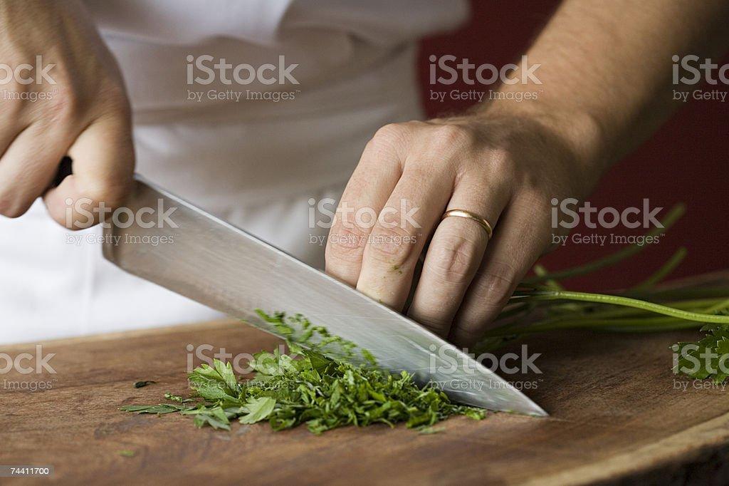 Chef chopping parsley stock photo