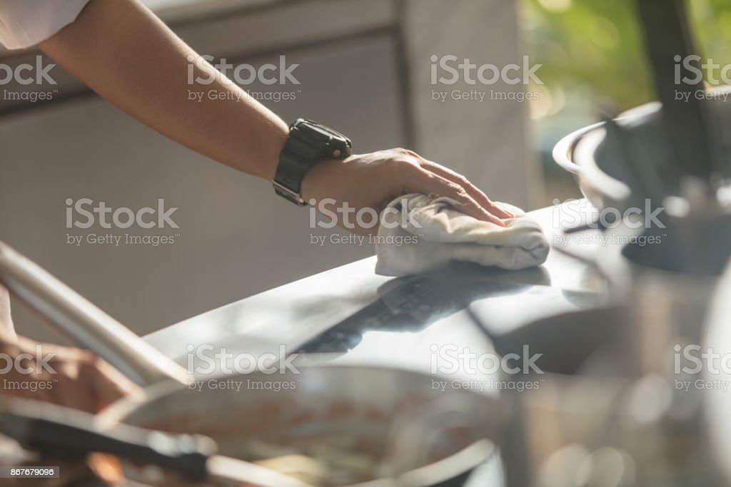 Chef cleaning after preparing food stock photo
