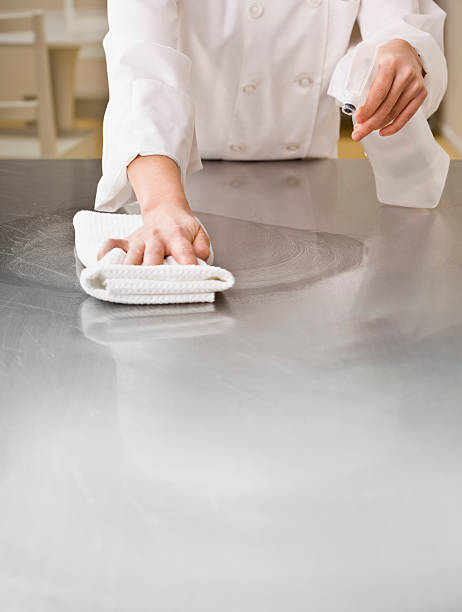 Chef Cleaning Counter stock photo