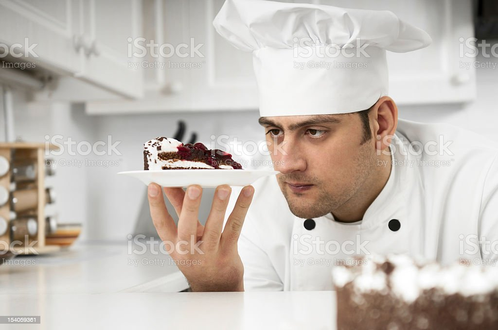 Chef closely examining dessert plate stock photo