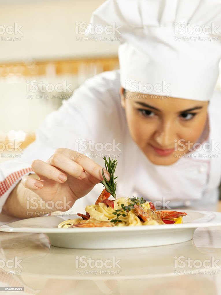 Chef Completing Pasta royalty-free stock photo