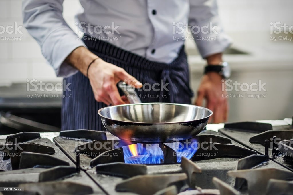 Chef controls the cooking process stock photo