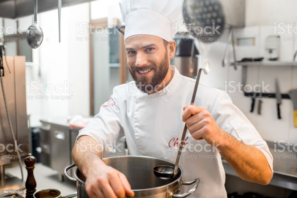 Chef cook at the kitchen stock photo