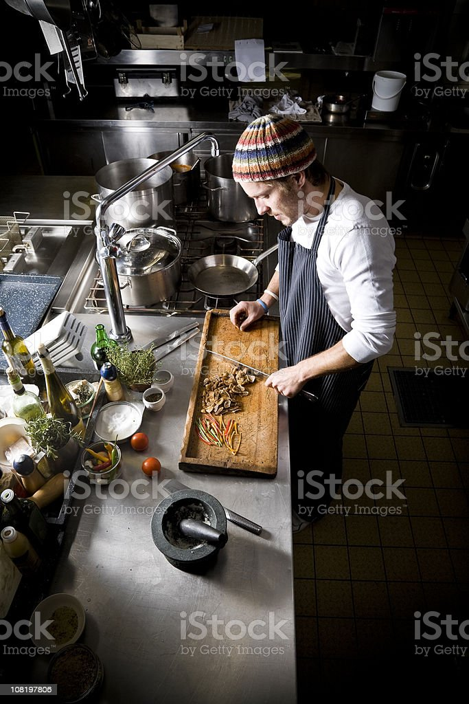 Chef Cook Cutting and Preparing Food in Restaurant Kitchen stock photo