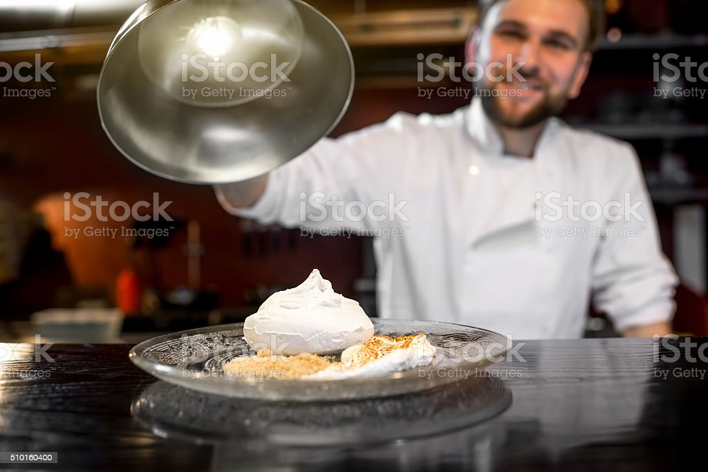 Chef cook serving dessert to the client stock photo