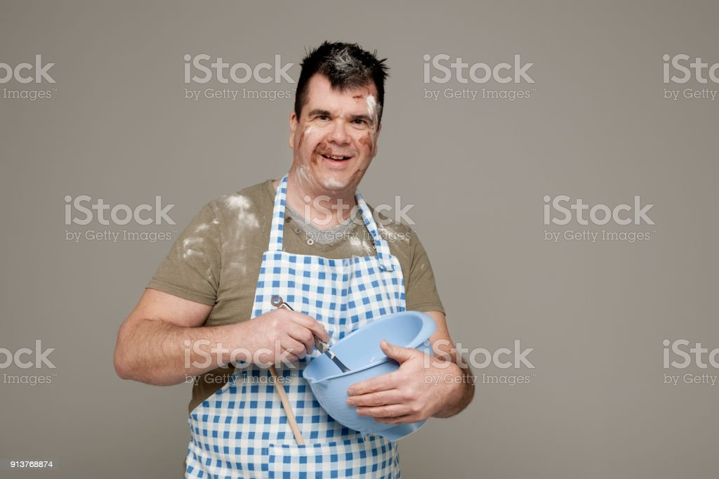 chef cook with mixing bowl stock photo