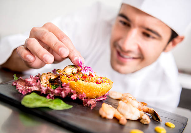 Chef cooking at the restaurant stock photo