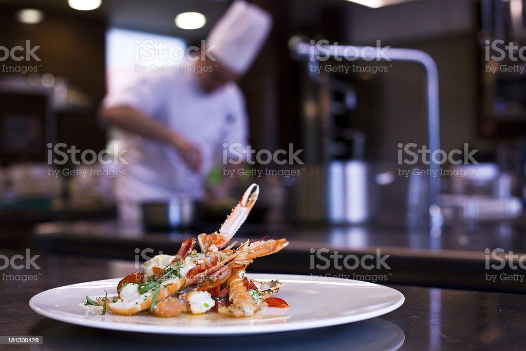 Chef Cooking in Restaurant Kitchen stock photo