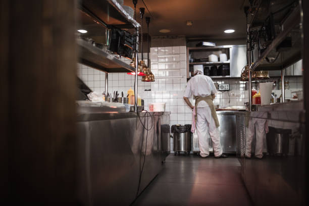 Chef cooking in the modern kitchen in a high-end restaurant stock photo