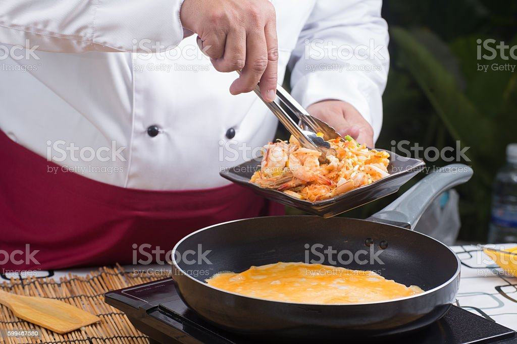Chef cooking Pad Thai stock photo