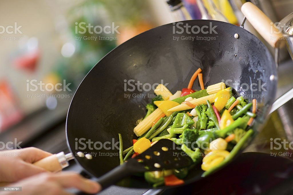 Chef cooking wok stock photo