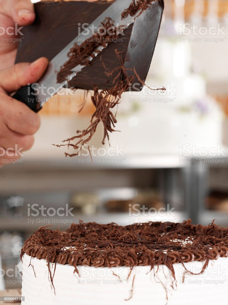 chef cutting chocolate stock photo